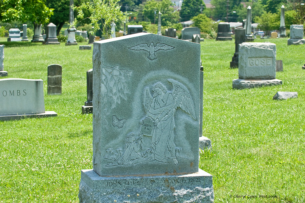 """Some of the """"newer"""" headstones had drawings curved into them."""