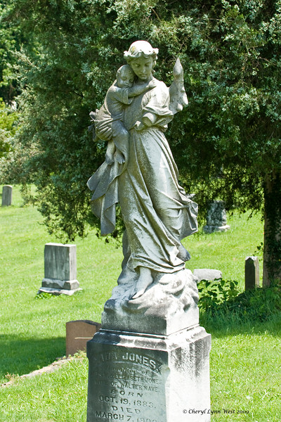 Ada Jones, wife of Walter Nave, died at the age of 18 years old.  As the angel is holding a baby, it might be thought that Ada died in child birth, perhaps with the child, although there is no small headstone or mention of a baby.