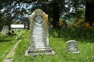 The little grave on the right is that of a child who died at birth.  Many of the graves in this cemetery are those of children who lived only a short time.