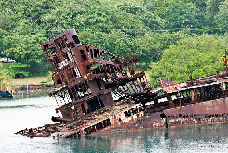 Close-up of rusted hull of a ship in the port of Roatan