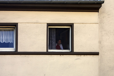 Jörg looking out of the window of my apartment