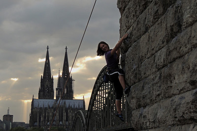 Climbing at the Hohenzollernbridge in Cologne
