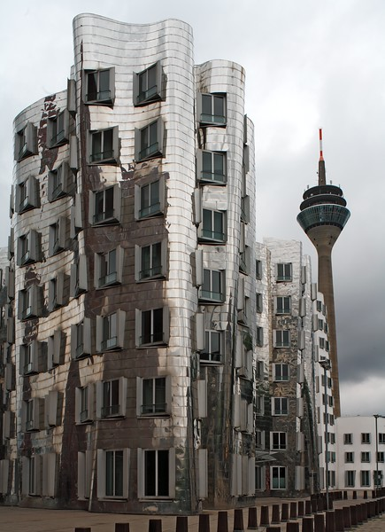 The Neuer Zollhof building by Frank Gehry at the Medienhafen Media Harbour and the Rhine Tower, Dusseldorf, Germany, Europe