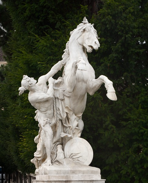 Statue of a young man curbing a horse. Located outside of Maria Theresien Platz, Vienna, Austria