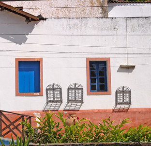 A white wall with colored windows, Ceara, Brazil, South America.