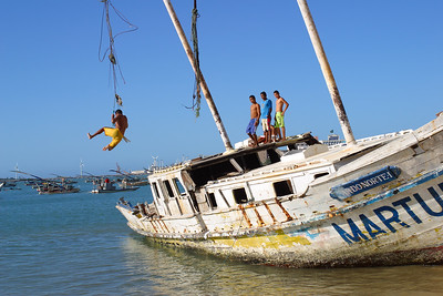 Brazil boys plaing on a shipwreck in  the Fortaleza harbour, Ceara, Brazil, South America.