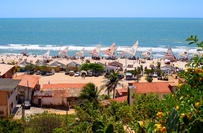 A Brazilian fishing village and traditional fishing boats (jangadas), Canoa Quebrada, Ceara, Brazil, South America.