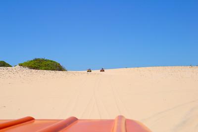 Riding in a dune buggy Canoa Quebrada, Ceara, Brazil, South America. on a Brazilian beach, Canoa Quebrada, Ceara, Brazil, South America.