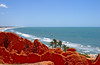 Colorful red sanstone formations at Canoa Quebrada, Ceara, Brazil, South America.