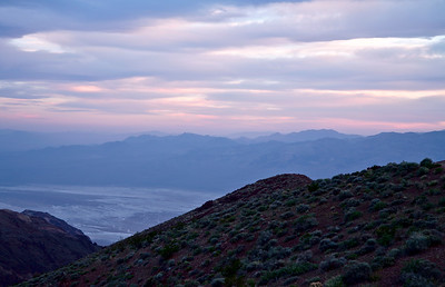Sunset from Dantes View in the Black Mountain Range, Death Valley National Park, California and Nevada, USA. The view includes the Badwater area and the extensive salt flats as well as mountains of the Panamint Range.
