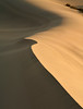 Light, shade and shapes of Stovepipe Sand Dunes, Death Valley National Park, California and Nevada, USA.