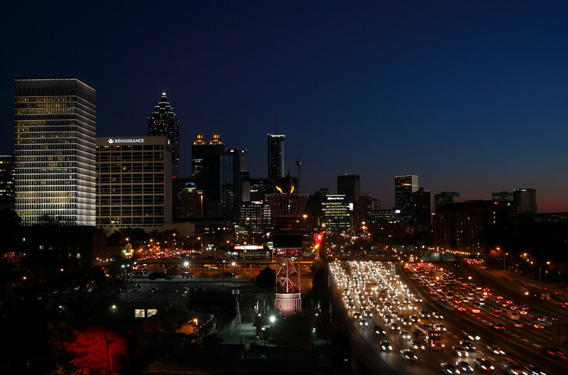 Atlanta Midtown skyline and Friday night traffic at James Wendell George Parkway, Georgia, USA.