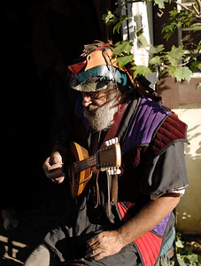 Man in period attire playing a mandolin at Maryland Renaissance Festival, Crownsville, Maryland, USA.