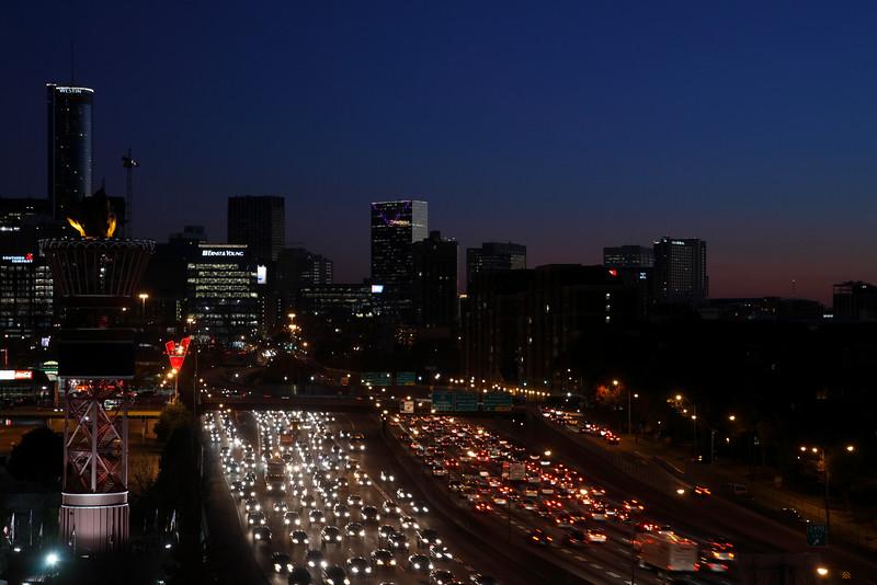 Atlanta Midtown skyline and Friday night traffic at James Wendell George Parkway, Georgia, USA.