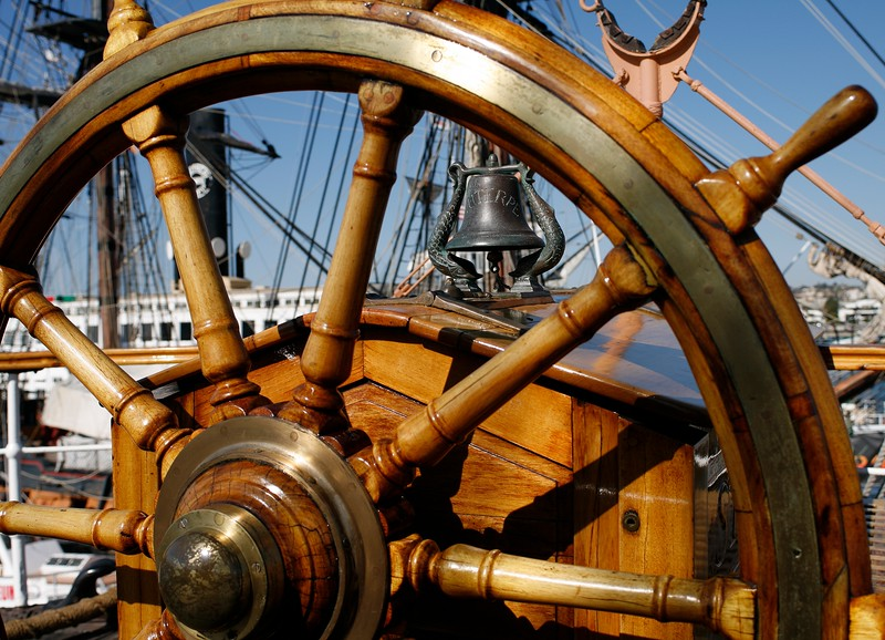 Ship wheel and bell of Star of India, built in 1863 as Euterpe