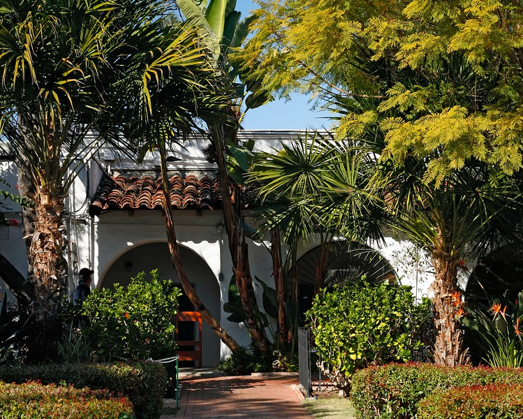 Old authentic building and tropical trees in Old Town of San Diego, California, USA