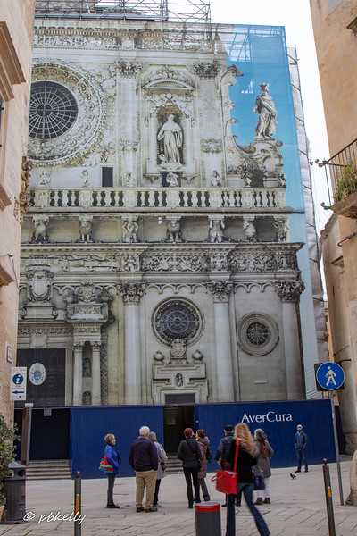 Chiesa Santo Croce is one of the elaborately Baroque churches in Lecce.  The facade is under repair, so this curtain, with a full image of the facade, covers it.