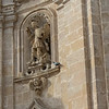 Closer up on the previous door.  You can see what is probably St. Micheal the Archangel stomping on a cute little demon.  The little guy has his left arm around the angel's leg.