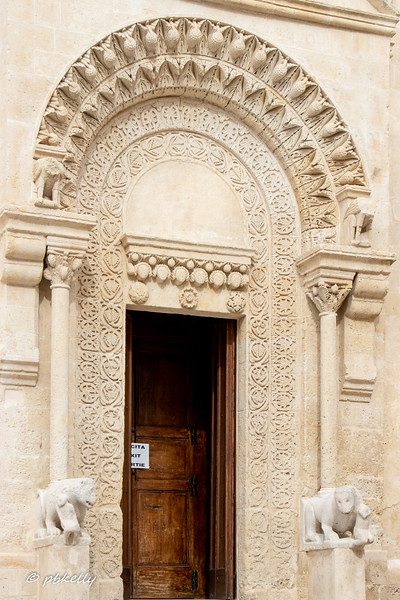 Another Cathedral door.  The beast on the right looks like it has another baby.