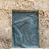 """While I was studying this bronze plaque in a wall in Matera, I noticed the sign above it which said 'Lions Int""""."""