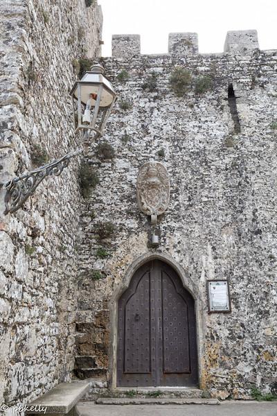Door in the wall.  Sign says restaurant.