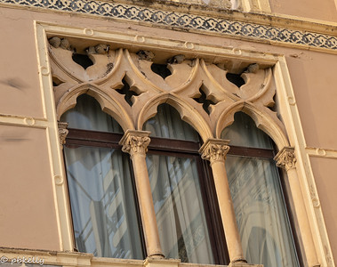 091521.  Swallows utilizing the ornate windows in our hotel for nests.  Wish I had a longer lens for this one.