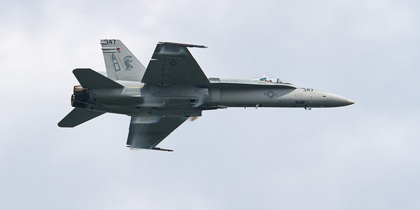 An F-18 Hornet traveling well over 600mph (probably closer to 700mph - just a tad under supersonic).