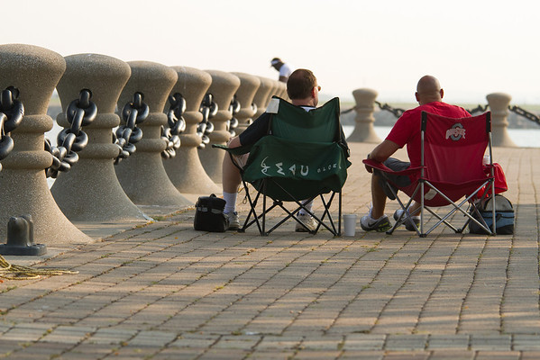 Two friends avoid the weekend crowd by watching the Friday afternoon practice runs.