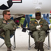 Two pilots, seated next to an A-4 Skyhawk, watch the crowd.<br /> 2011 Cleveland National Air Show