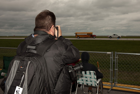 Doug Hupfer taking a photograph of the Jet School Bus<br /> 2011 Cleveland National Air Show