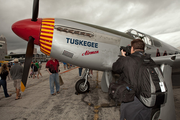 Doug Hupfer capturing a photo of a P-51 Mustang<br /> 2011 Cleveland National Air Show