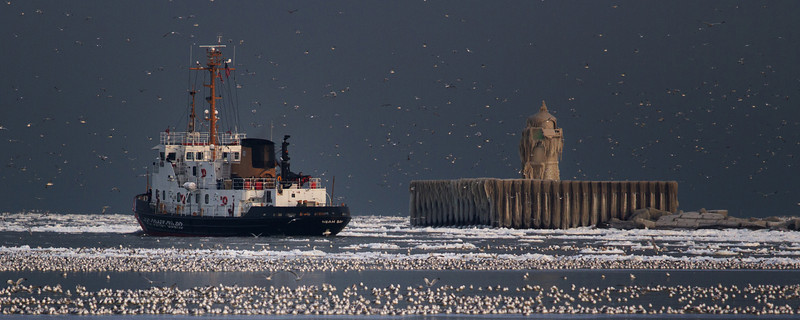 """The Neah Bay Ice Cutter passes a frozen break water marker on a cool early December morning.<br /> Sized for both 20x8"""" and 30x10"""" Panoramic Portrait."""