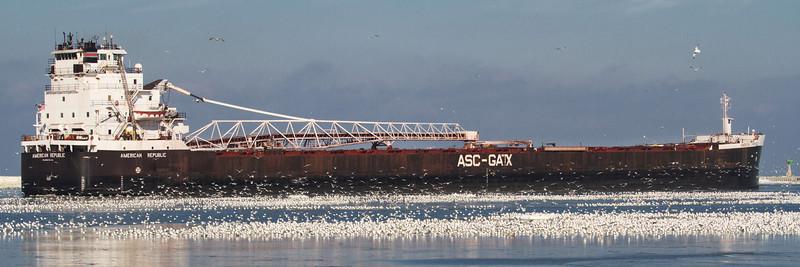 "A really big ship (AMC - American Steamship Company) navigating to a shipyard at Whiskey Island<br /> Sized for a 30x10"" Panoramic Print"