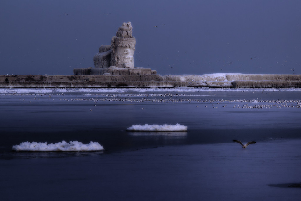 I really like this shot - very dreamy and mystical feeling.  Cleveland Harbor West Pierhead Lighthouse/Icehouse.