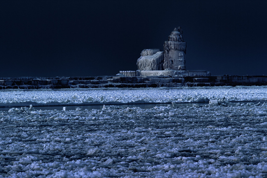 Is it from another planet?  The Cleveland Harbor West Pierhead Lighthouse, better know as the Icehouse of late, lies frozen in time under a dark December night sky.
