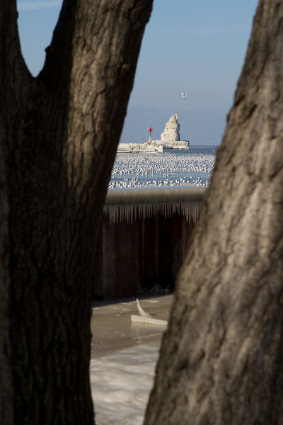 A view of the Cleveland Harbor West Pierhead Lighthouse from the US Coast Guard Station (now abandoned).