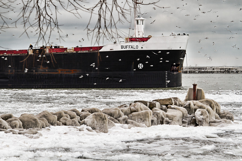 A freighter leaving a Whiskey Island Port on Christmas Eve.