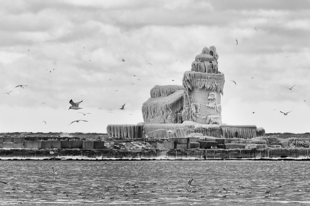 Black and White image of the Cleveland Harbor West Pierhead Lighthouse/Icehouse.  Check out the old fisherman embedded on the front of the lighthouse.  He kind of looks like the fisherman who sings the theme song for Sponge Bob Square Pants.