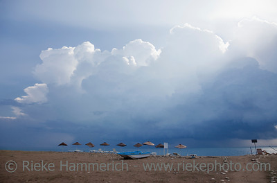 Beach with damaged Umbrellas after severe Weather - Cirali, Turkey, Asia