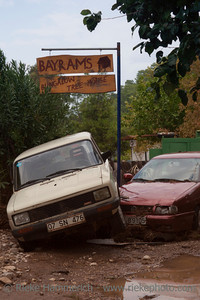 Two Crashed Cars in front of Tree Houses - Flood Disaster in Olympos, Turkey, Asia