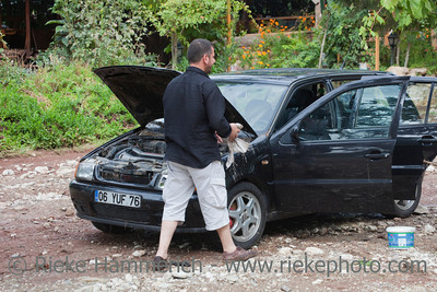 Man washing his car after Flood Disaster - Olympos, Turkey, Asia
