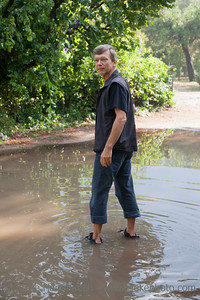 Mature Man standing in big Puddle - Cirali, Turkey, Asia