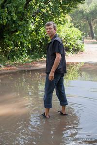Mature Man standing in big Puddle - Cirali, Turkey, Asia