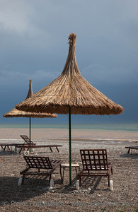 Straw Umbrellas with Sun Loungers on Beach - Tourist Resort in Cirali, Turkey, Asia