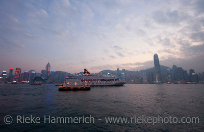 Skyline of Hong Kong at Dusk - Cruise Ship and Star Ferry in front of Hong Kong Island, China, Asia