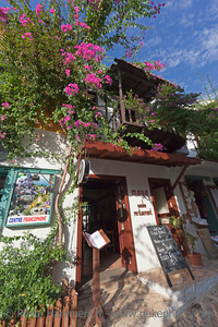 Kas, Turkey - October 15, 2009: Maya Garden Restaurant in the village Kas in Turkey. Kas is a small fishing, diving, yachting and tourist town and part of Antalya Province. The picturesque houses in the city of Kas are famous for wooden balconies and white facades.