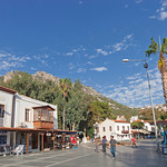 Kas, Turkey - October 15, 2009: Town Square named Cumhuriyet Meydani with walking men and traditional town houses in the Village Kas in Turkey. Kas is a small fishing, diving, yachting and t ...