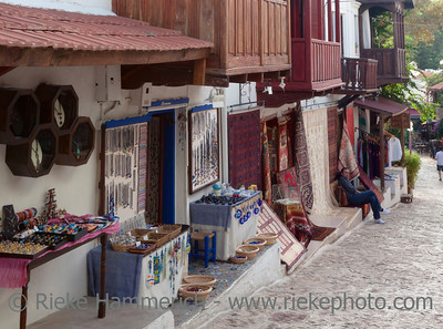 Kas, Turkey - October 15, 2009: Jewelry and carpet store in traditional town houses in the village Kas in Turkey. Kas is a small fishing, diving, yachting and tourist town and part of Antalya Province. The picturesque houses in the city of Kas are famous for wooden balconies and white facades.
