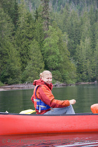 Young woman canoeing - Clearwater Lake, Wells Gray Provincial Park, British Columbia, Canada