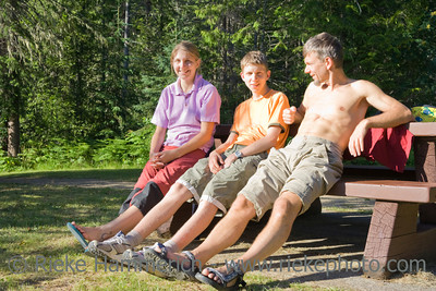 Happy family on bench - Wells Gray Provincial Park, British Columbia, Canada